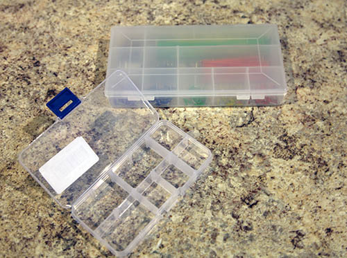 Use the plastic trays that come with removable tabs. This will allow you to use them for many different sized parts.