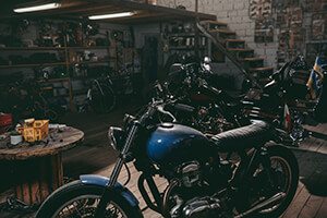 cluttered and warm motorcycle garage scene