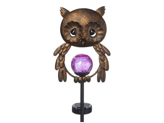 lighted garden statue in the shape of an owl