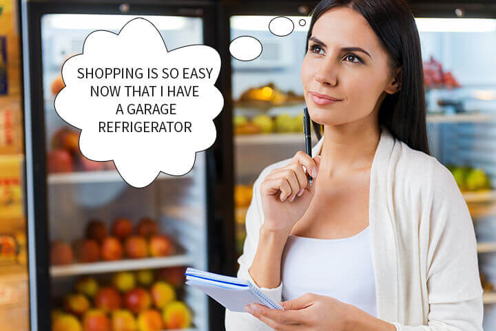 Woman thinking about her garage refrigerator