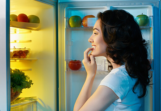Woman looking in her refrigerator