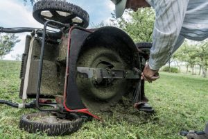 Lawn mower blades covered with grass