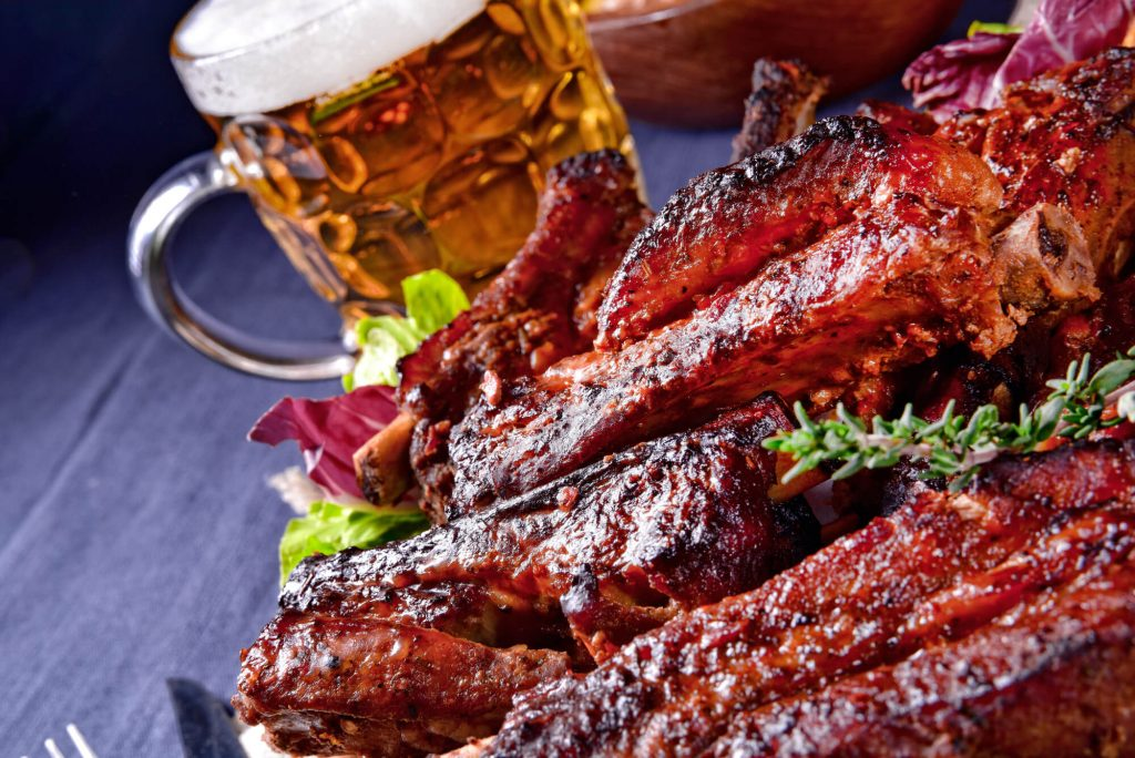 Ribs and beer on table