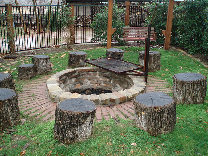 stumps as chairs around a fire pit