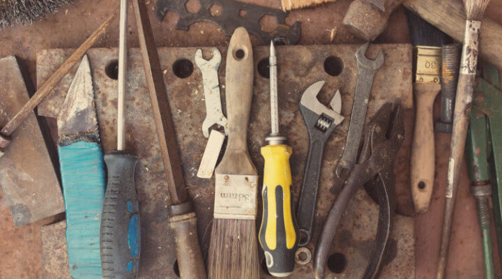 set of dirty and rusty hand tools